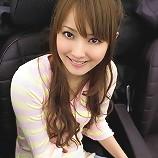 Adorable asian cutie with a beautiful smile in a pink bikini