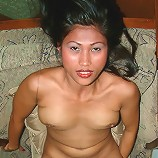 Long-legged Asian MILF shows off pussy in white heels