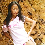 Really tiny Thai teen poses in cute outfit on the seaside rocks