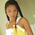 Thai girl Tailynn in pigtails shows off her asset