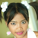 Really young looking Thai teen skips rope in pigtails