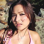 Busty asian amateur doing sexy poses on a public beach here