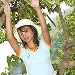 18 year old Thai teen plays in a tree by the sea